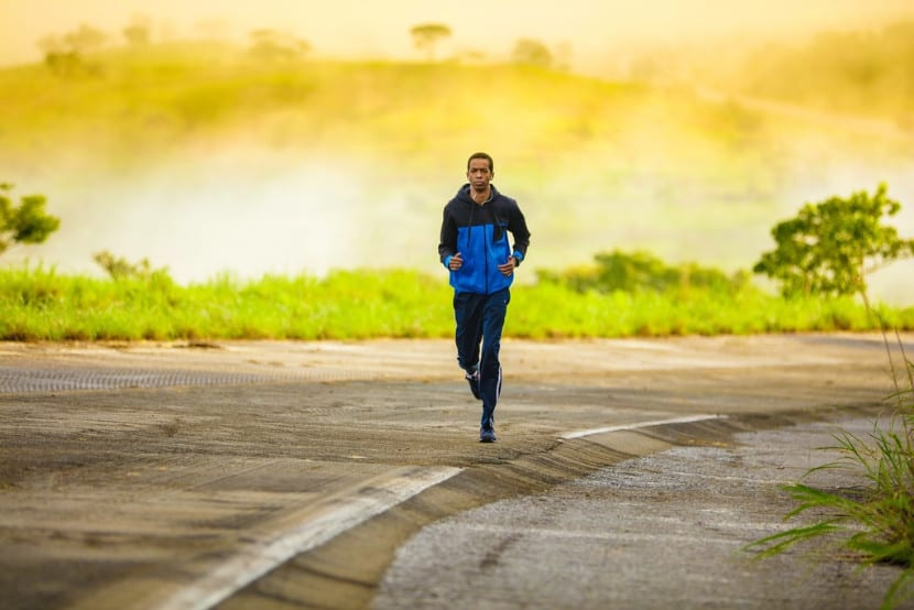 Man running at sunrise to lose weight